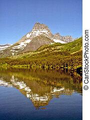 Mt. Wilbur at Swiftcurrent Lake - Mt. Wilbur reflected in...
