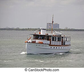 Vintage Yacht - A well kept vintage yacht cruising on the...