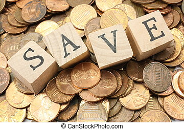 Save Pennies - A background of US pennies with wooden blocks...