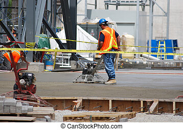 Concrete Finishers - construction workers finish a fresh...