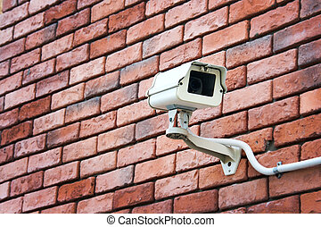 cctv on the brick wall - CCTV security your property on the...