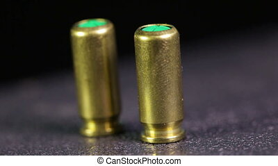 Bullets - Macro two rounds of spinning to starting gun