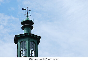Weathervane - steeple top weathervane against clouds and...