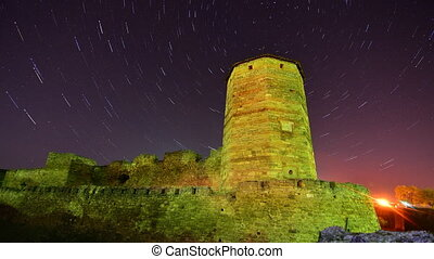Old stone tower night timelapse - Old stone tower on starry...