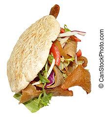 Doner Kebab - A takeaway doner kebab in a pita bread,...