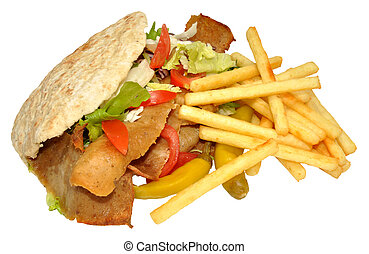 Doner Kebab And Fries - A takeaway doner kebab in a pita...