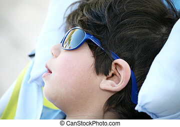 Toddler boy with sunglasses