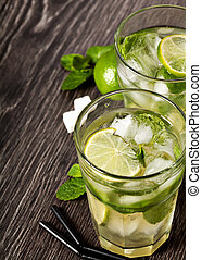 Summer cold cocktail drink mojito on dark background