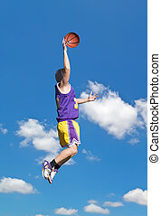 yellow and purple dunk in the sky - basketball player...