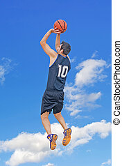 jump shot in the sky - basketball player shooting in the sky