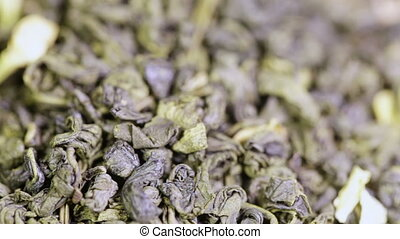 Green tea with jasmine - Macro rotating green tea with...