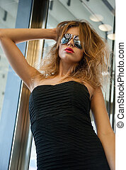 beautiful woman in sunglasses in elevator - fashion and...