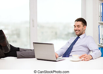 smiling businessman or student with laptop - office,...