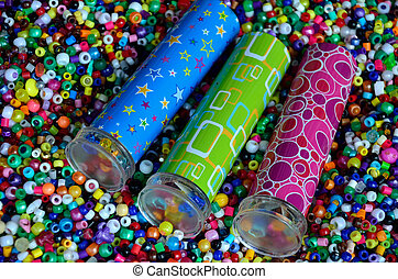 Three kaleidoscopes in beads - Three toy kaleidoscopes lying...