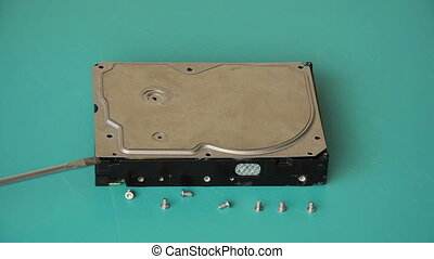 Showing broken hard disk - Technician opening the cover of...