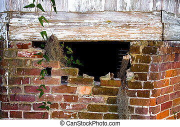 Hole in crumbling brick foundation - Hole in the crumbling...
