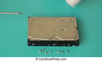 Opening the hard drive box - Someone opening the cover of...