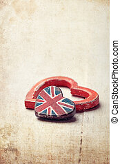 Two hearts - one with Union Jack - on wooden board, vintage...