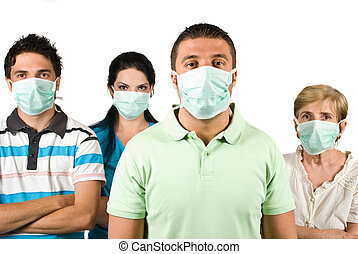 Group of people with protective mask standing with hands...