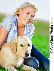 Close up of woman with golden retriever in the park