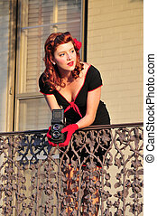 lady using vintage camera - beautiful retro girl taking a...