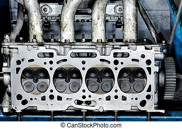 Worn out engine head with four valves per cylinder