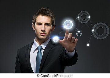 Businessman working with hightech touchscreen pressing...