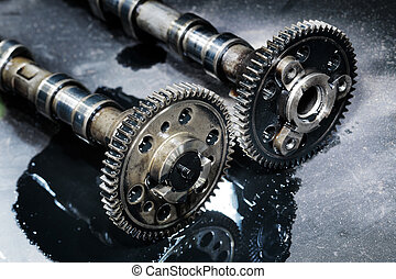cam shaft of a turbo diesel engine on a dark background