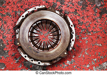an old worn out vehicle clutch