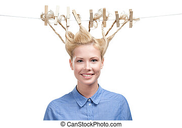 Woman with creative haircut of clothes pegs