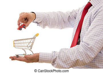 Buy a car - Shopping concept - Hand putting a car on a...