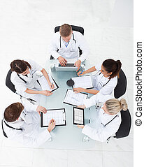 Doctors Analyzing Medical Records - High angle view of...