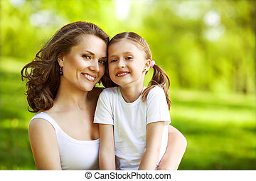 Mother and her child enjoy the early spring. Mother day. -...