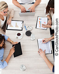 Businesspeople Working At Desk - High angle view of business...