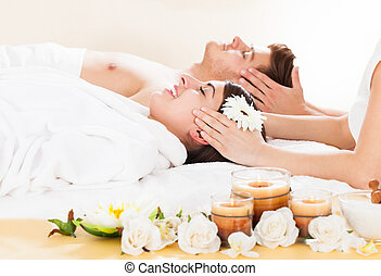 Couple Receiving Head Massage - Young couple receiving head...