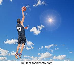 right dunk in the sky - basketball player doing a right dunk...