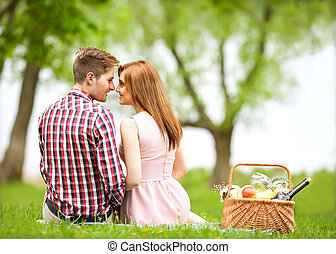 Couple in love in sitting near the river, picnic Valentines...