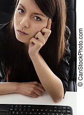 business woman sitting at her desk - office worker sitting...