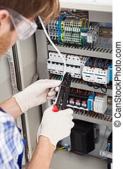 Electrical Engineer Repairing Fusebox - Cropped image of...