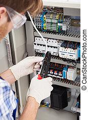 Electrical Engineer Repairing Fusebox - Cropped image of...