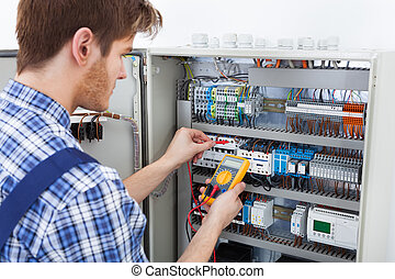 Technician Examining Fusebox With Insulation Resistance...