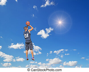 shooting in the sun - basketball player shooting in the sun