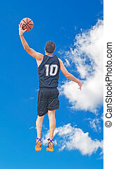 shot in the sky - basketball player shooting in the sky