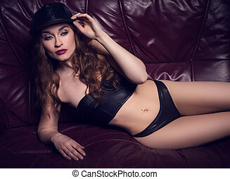 sexy woman wearing leather lingerie and hat