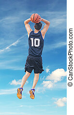 slam dunk with clouds - basketball player dunking in the sky