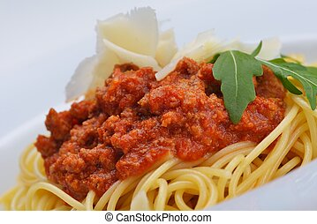 Italian spaghetti topped with bolognaise, or bolognese,...