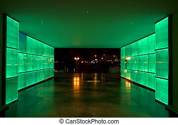 Green light tunnel - Tunnel with neon lights on each side in...