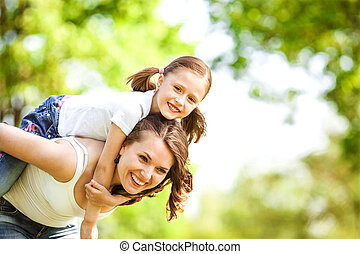 Mother and daughter in park. Mother Day.