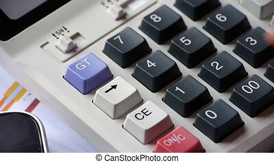 checking financial data on calculator.examining business...
