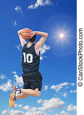 two-handed jam in the sun - basketball player doing a...